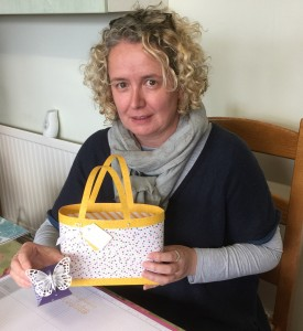 Kate with the bag and butterfly box she made. :-)